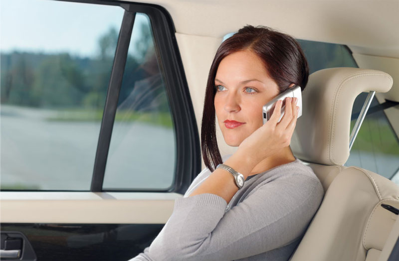 chauffeursdirect-passenger-on-phone